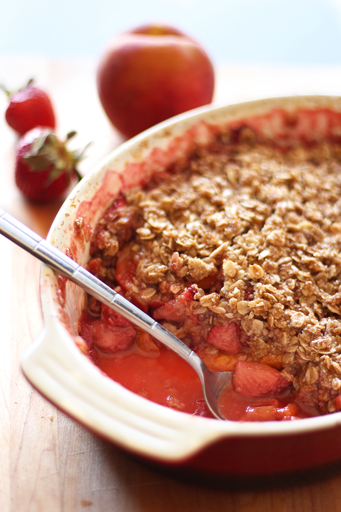 This strawberry peach crumble is an incredibly easy and AMAZING summer dessert. Made vegan and naturally gluten free!
