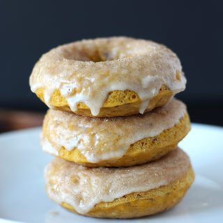 These quick and easy Vegan Pumpkin Spice Donuts topped with maple glaze and cinnamon sugar are the absolute perfect Fall treat for all donut lovers!